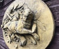 Hunting hare oval wall plaque in relief